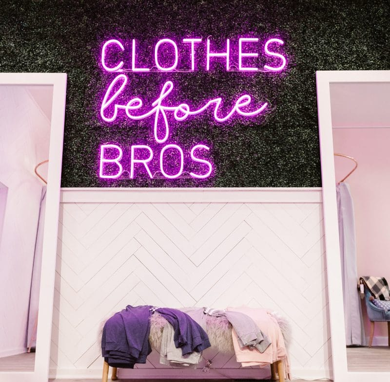 Clothes before Bros neon sign